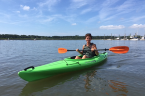 A Woman kayaks around Hilton Head Island